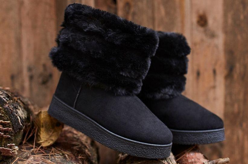 Stylizacje z czarnymi śniegowcami – zimowe inspiracje, które musisz znać!